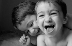 twins laughing together