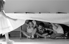 children hiding under table